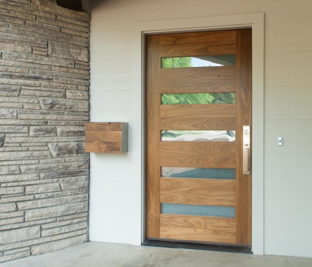 Oak door with alternating tall wood and short glass panels.