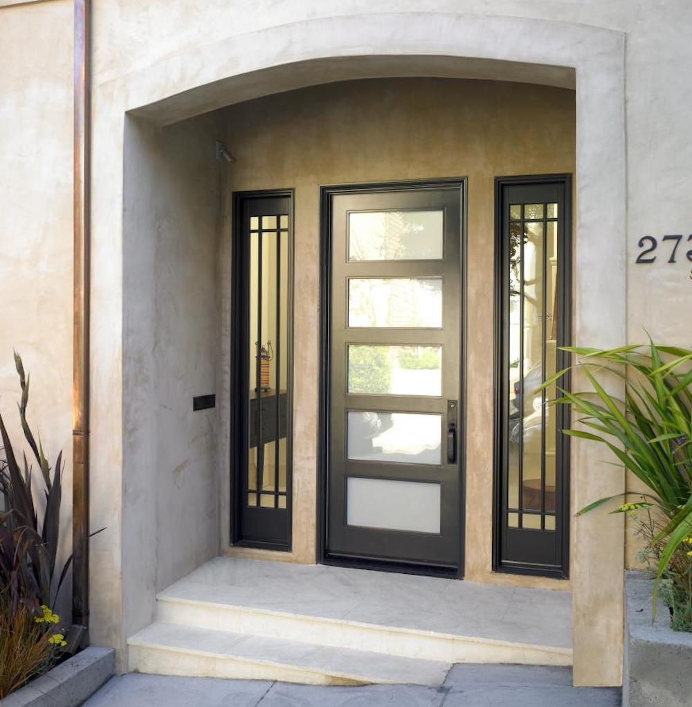 Black front door with opaque glass panels and two sidelites with clear glass.