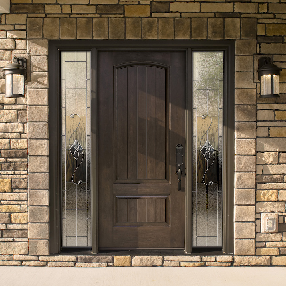 Dark stained front entry door with dark bronze hardware and sidelites with decorative glass on each side of the door.