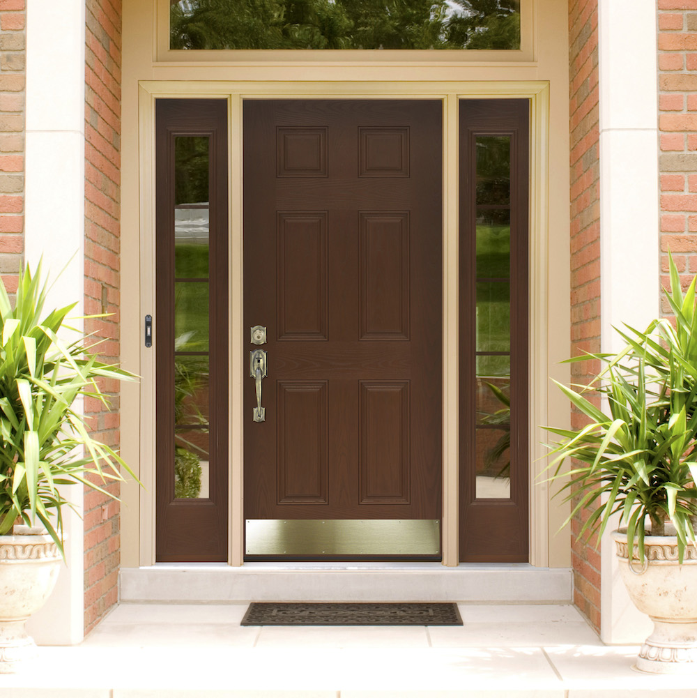 Brown fiberglass door with brass hardware and kickplate, left and right sidelites and transom.