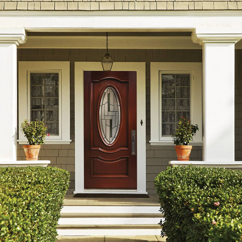 Elegant front door with decorative glass in center oval.