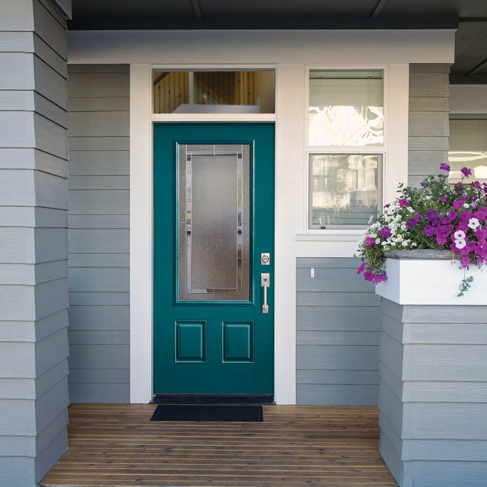 Teal front door with decorative privacy glass on gray house.