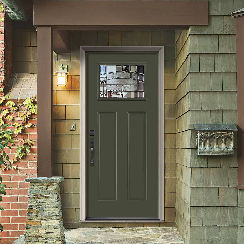 Moss green front door with dark hardware and decorative glass.