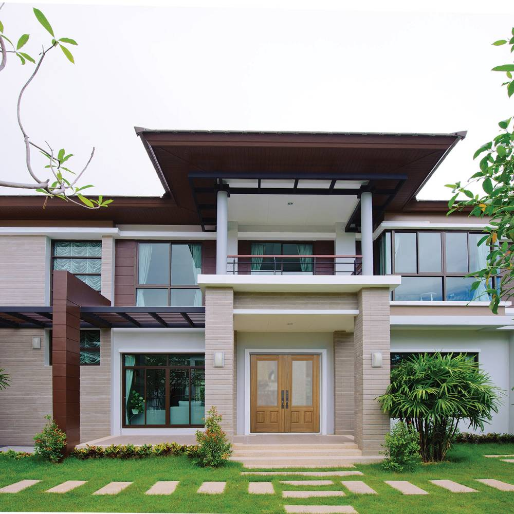 Double doors with glass on two-story modern house