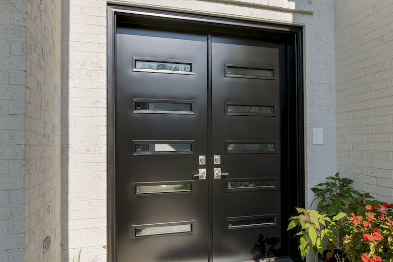 Front entry steel black front doors with glass slots and nickel hardware.