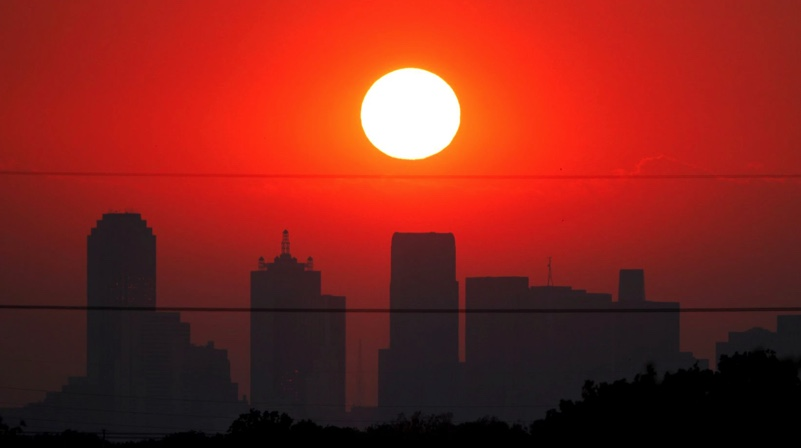 August sunset over Dallas skyline.