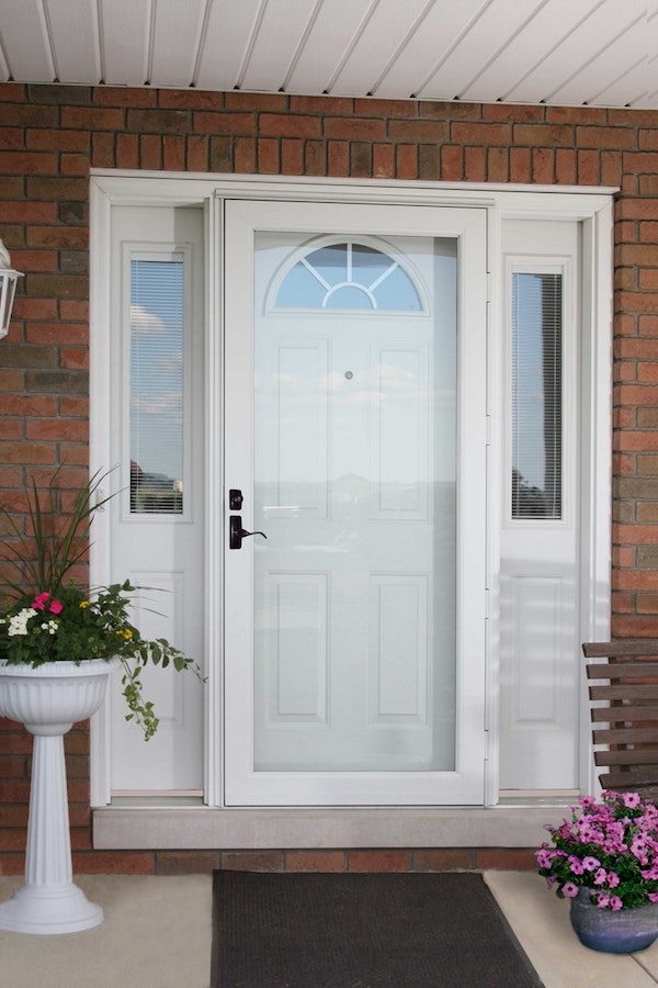 White ProVia storm door with curved handle.