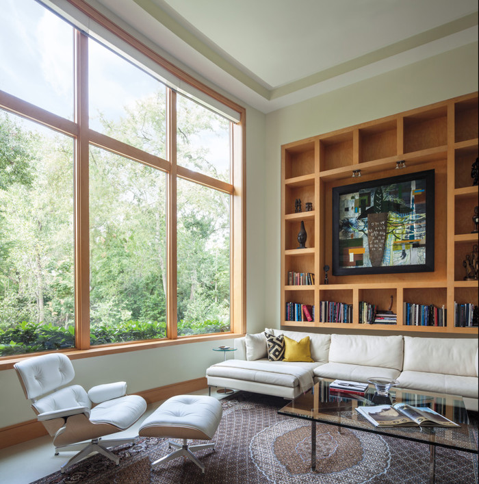 Andersen E-Series wood clad windows with stained wood interior.