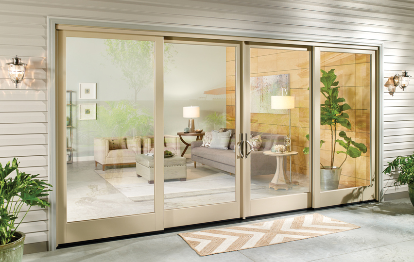 Home exterior with double sliding glass doors.