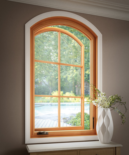 Milgard Essence wood and fiberglass radius casement style window. Brennan Enterprises is a Milgard window dealer in North Texas.