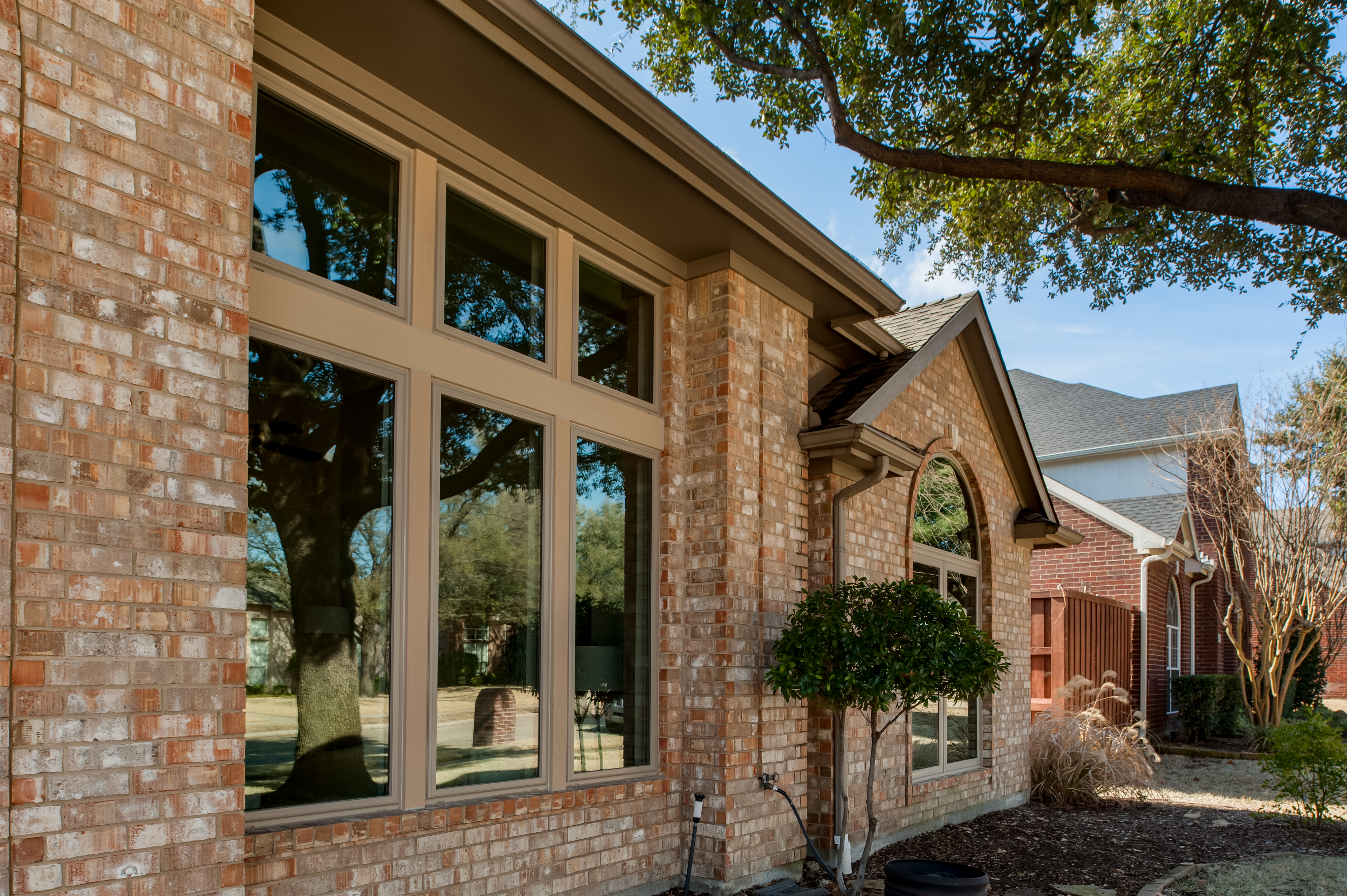 Example of vinyl windows from Brennan Enterprises. This image features Brennan Traditions vinyl casement windows.