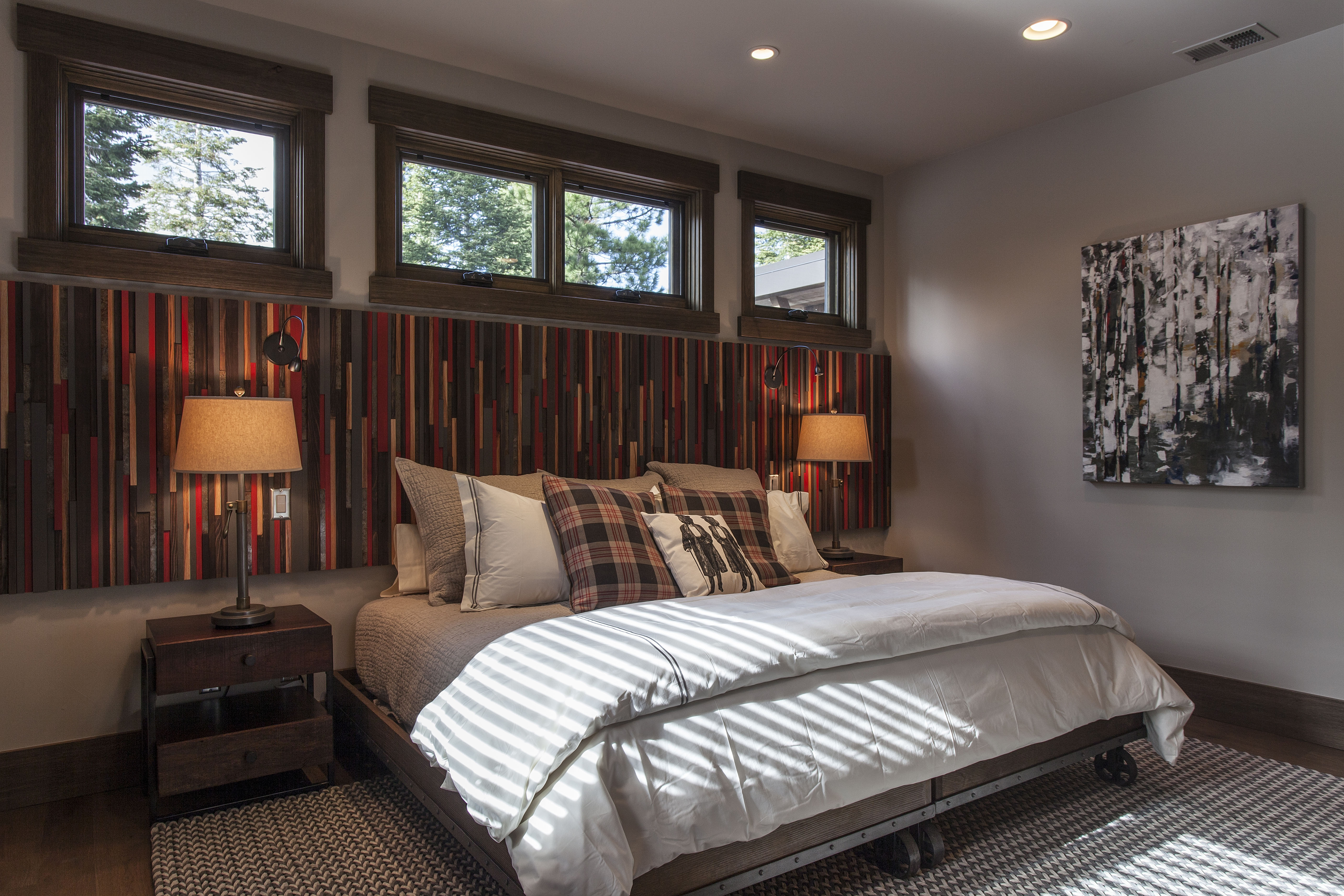 Sierra Pacific offers solid wood windows. In this photo wood awning windows above the bed bring in additional light to this bedroom.