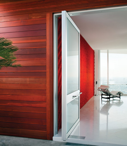 weiland glass and metal door with red walls and a city view