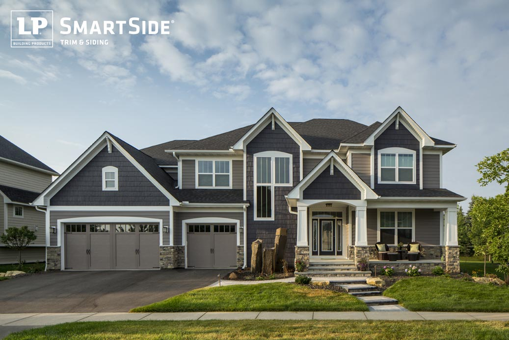 Navy blue, gray, and white suburban house with 3-car garage
