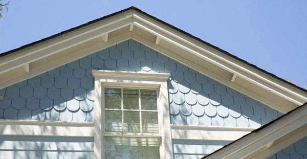 Round-edge (scallop) siding on gable around window.