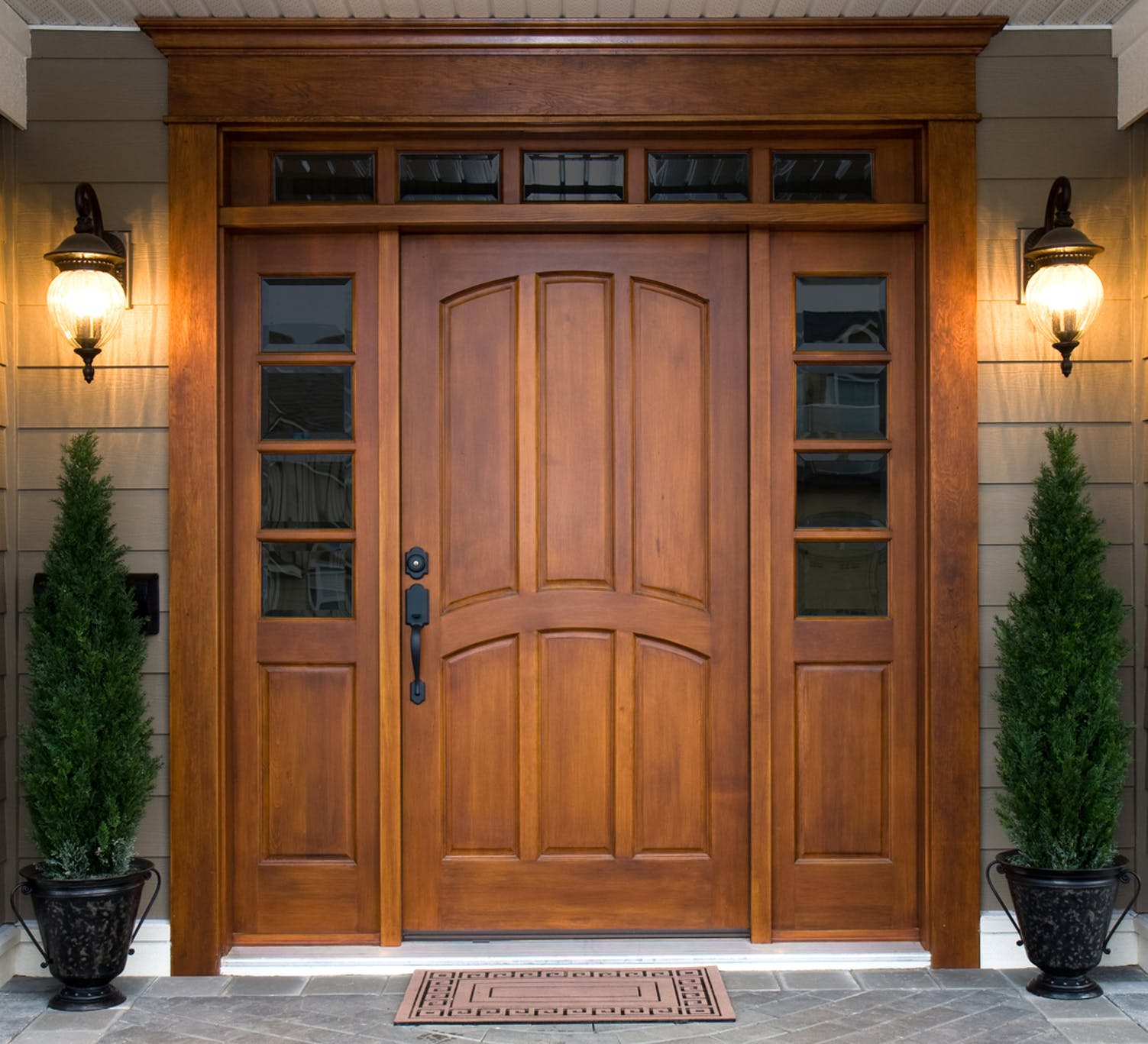 Elegant and classic wood door with sidelites and transom lites.
