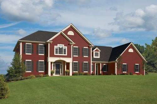 Deep red siding as an alternative to a traditional brick facade.