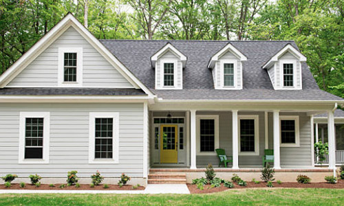 Example Of A Cape Cod Style House This Features Hung Windows With Grids And