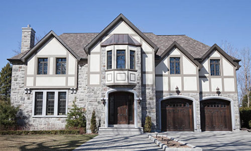 Casement and bay windows are popular on Tudor houses. Brennan Enterprises is a replacement window company in Dallas, Texas.