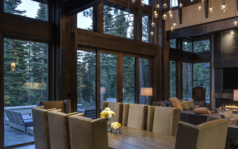 Interior view of dark stained Sierra Pacific all-wood windows. Wood windows add warmth and sophistication to any space.