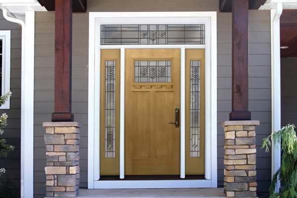 ProVia Signet Fiberglass door in a Honey Wheat stain. The Honey Wheat stain on this door has a yellowish tint that helps create a bright and welcoming feature to your front entrance.