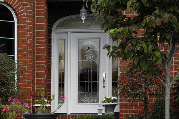 This ProVia Legacy door in a white finish features two sidelites and a transom lite.