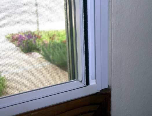 Image of interior storm window. Interior storm windows provide an extra layer of protection against outside elements.