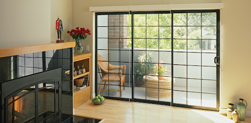 Interior view of Brennan installed three module black aluminum patio doors with grids.