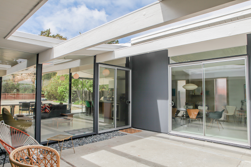 Aluminum sliding patio doors installed by Brennan provide generous views and natural light.