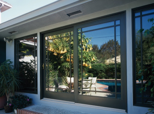 Brennan installed Milgard patio doors with mirror glaze for privacy.