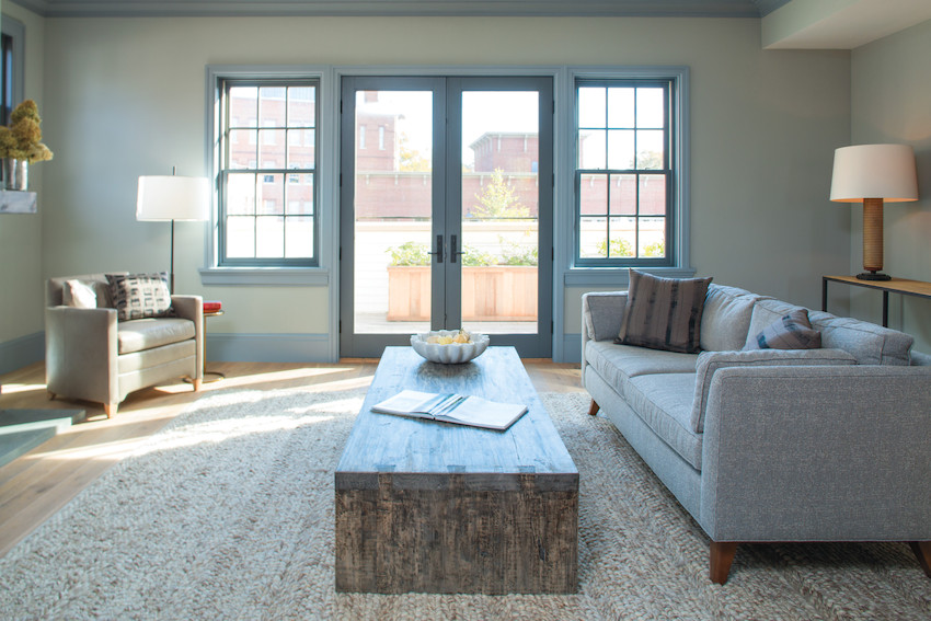 Photo of Andersen E-Series windows in Dove Gray finish. The windows blend in nicely in this cool tone living room.