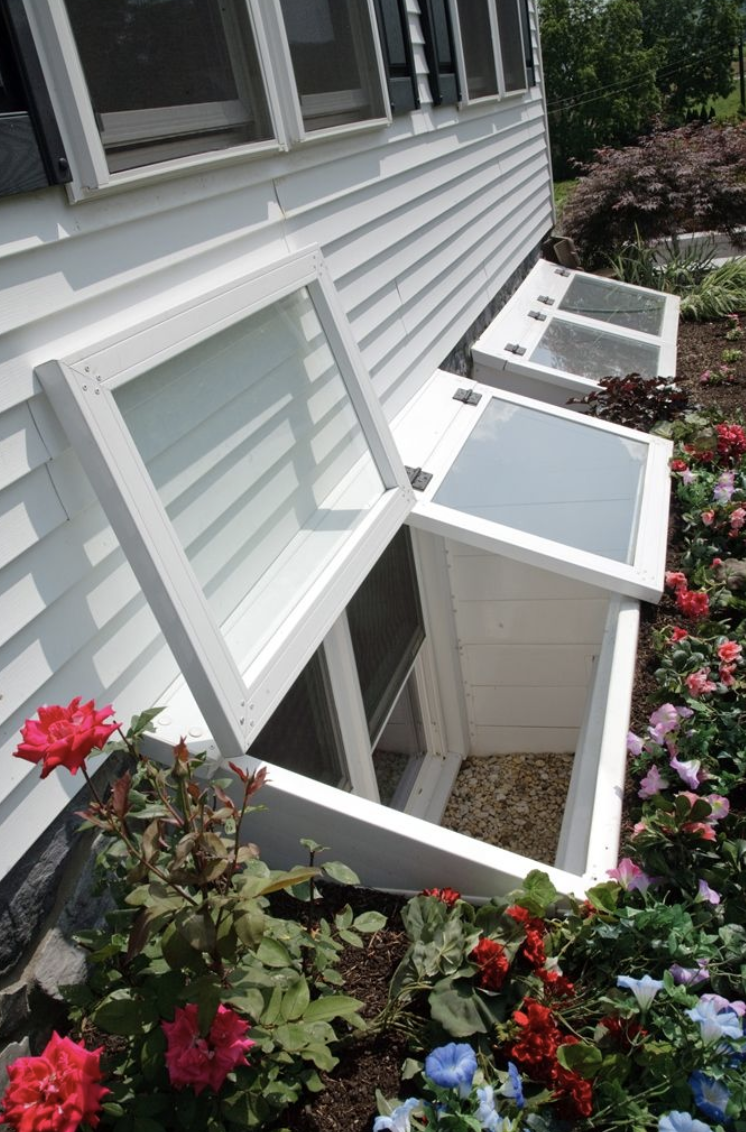 Egress window functionality can be enhanced with wells which offer stairs to grade level and covers to deter water accumulation.