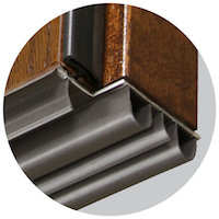 Embarq door's custom designed sweep with multiple layers for thermal barriers.