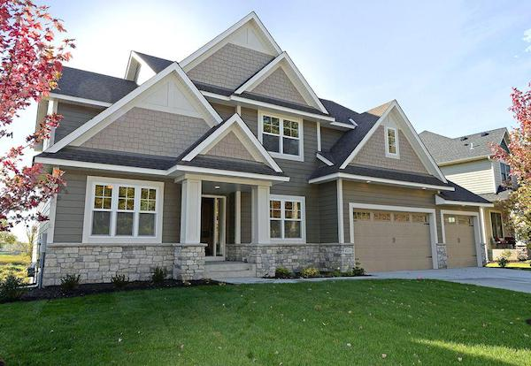 Modern craftsman style house with staggered edge shingles in gables.