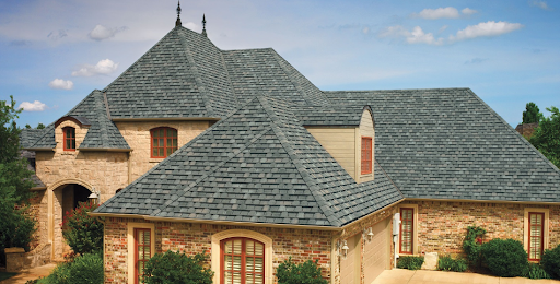 Camelot roofing shingles on a mixed facade home.
