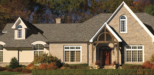 Neo-french home with mixed material facade and wood accents with Camelot II roofing shingles.