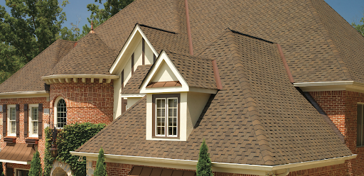Large Neo-Victorian with light brown designer shingles.