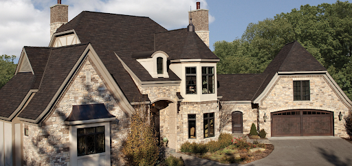 Large neo-french mansion with dark Woodland Designer Roofing Shingles.