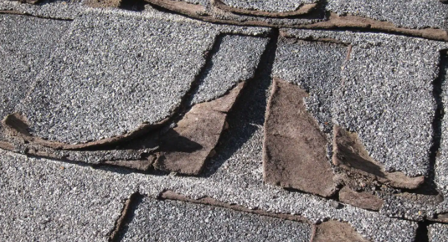 asphalt shingles with missing granules.